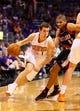 Oct 30, 2013; Phoenix, AZ, USA; Phoenix Suns guard Goran Dragic (1) drives to the basket against  Portland Trail Blazers forward Nicolas Batum (88) in the second half at US Airways Center. The Suns defeated the Blazers 104-91. Mandatory Credit: Mark J. Rebilas-USA TODAY Sports