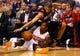 Oct 30, 2013; Phoenix, AZ, USA; Phoenix Suns guard Eric Bledsoe (bottom) is fouled by Portland Trail Blazers forward Nicolas Batum (88) in the fourth quarter at US Airways Center. The Suns defeated the Blazers 104-91. Mandatory Credit: Mark J. Rebilas-USA TODAY Sports
