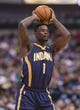 Oct 25, 2013; Dallas, TX, USA; Indiana Pacers shooting guard Lance Stephenson (1) looks to pass the ball during the game against the Dallas Mavericks at the American Airlines Center. The Pacers defeated the Mavericks 98-77. Mandatory Credit: Jerome Miron-USA TODAY Sports