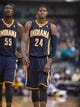 Oct 25, 2013; Dallas, TX, USA; Indiana Pacers center Roy Hibbert (55) and shooting guard Paul George (24) during the game against the Dallas Mavericks at the American Airlines Center. The Pacers defeated the Mavericks 98-77. Mandatory Credit: Jerome Miron-USA TODAY Sports