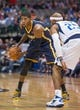 Oct 25, 2013; Dallas, TX, USA; Indiana Pacers shooting guard Paul George (24) looks to pass the ball by Dallas Mavericks shooting guard Vince Carter (25) during the game at the American Airlines Center. The Pacers defeated the Mavericks 98-77. Mandatory Credit: Jerome Miron-USA TODAY Sports