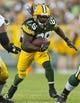 Aug 23, 2013; Green Bay, WI, USA; Green Bay Packers running back DuJuan Harris (26) rushes with the football during the first quarter against the Seattle Seahawks at Lambeau Field. Mandatory Credit: Jeff Hanisch-USA TODAY Sports