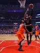 Oct 31, 2013; Chicago, IL, USA; Chicago Bulls power forward Carlos Boozer (5) shoots over New York Knicks center Tyson Chandler (6) during the second half at the United Center. Chicago won 82-81. Mandatory Credit: Dennis Wierzbicki-USA TODAY Sports