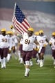 Oct 31, 2013; Pullman, WA, USA; (Editor's Note: Caption Correction) Arizona State Sun Devils defensive lineman Jake Sheffield (91) runs onto the field with an United States flag before the game against the Washington State Cougars at Martin Stadium. Mandatory Credit: Kirby Lee-USA TODAY Sports