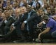Oct 30, 2013; Sacramento, CA, USA; Sacramento Kings advisor Chris Mullin (left) and owner Shaquille O'Neal (middle) and owner Vivek Ranadive (right) watch the on court entertainment during a timeout at Sleep Train Arena. Mandatory Credit: Ed Szczepanski-USA TODAY Sports