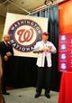 Nov 1, 2013; Washington, DC, USA; Washington Nationals manager Matt Williams (right) tries on his jersey during the press conference at Nationals Park. Mandatory Credit: Evan Habeeb-USA TODAY Sports