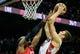 Nov 1, 2013; Atlanta, GA, USA; Toronto Raptors power forward Tyler Hansbrough (50) shoots a basket over Atlanta Hawks power forward Paul Millsap (4) in the first half at Philips Arena. Mandatory Credit: Daniel Shirey-USA TODAY Sports