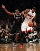 Nov 1, 2013; Brooklyn, NY, USA; Brooklyn Nets shooting guard Joe Johnson (7) and Miami Heat small forward LeBron James (6) fight for the ball during the first quarter of a game at Barclays Center. Mandatory Credit: Brad Penner-USA TODAY Sports
