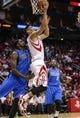 Nov 1, 2013; Houston, TX, USA; Houston Rockets point guard Jeremy Lin (7) scores a basket during the second quarter as Dallas Mavericks center Bernard James (5) defends at Toyota Center. Mandatory Credit: Troy Taormina-USA TODAY Sports