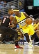 Nov 1, 2013; Denver, CO, USA; Portland Trail Blazers point guard Damian Lillard (0) guardsDenver Nuggets point guard Ty Lawson (3) in the second quarter at the Pepsi Center. The Trail Blazers won 113-98. Mandatory Credit: Isaiah J. Downing-USA TODAY Sports