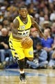 Nov 1, 2013; Denver, CO, USA; Denver Nuggets point guard Nate Robinson (10) controls the ball in the third quarter against the Portland Trail Blazers at the Pepsi Center. The Trail Blazers won 113-98. Mandatory Credit: Isaiah J. Downing-USA TODAY Sports