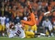 Nov 1, 2013; Corvallis, OR, USA; Southern California Trojans lineacker Dion Bailey (18) upends Oregon State Beavers receiver Brandin Cooks (7) at Reser Stadium. USC defeated Oregon State 31-14.  Mandatory Credit: Kirby Lee-USA TODAY Sports