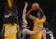 November 1, 2013; Los Angeles, CA, USA; Los Angeles Lakers shooting guard Xavier Henry (7) goes in for a basket against the San Antonio Spurs during the second half at Staples Center. Mandatory Credit: Gary A. Vasquez-USA TODAY Sports