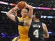 November 1, 2013; Los Angeles, CA, USA; Los Angeles Lakers center Chris Kaman (9) grabs a rebound against the San Antonio Spurs during the second half at Staples Center. Mandatory Credit: Gary A. Vasquez-USA TODAY Sports