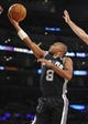 November 1, 2013; Los Angeles, CA, USA; San Antonio Spurs point guard Patty Mills (8) goes in for a basket against the Los Angeles Lakers during the second half at Staples Center. Mandatory Credit: Gary A. Vasquez-USA TODAY Sports