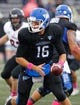 Oct 19, 2013; Buffalo, NY, USA; Buffalo Bulls quarterback Joe Licata (16) looks to hand the ball off against the Massachusetts Minutemen at University of Buffalo Stadium. Mandatory Credit: Timothy T. Ludwig-USA TODAY Sports