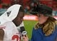 Oct 27, 2013; London, United Kingdom; Fox Sports sideline reporter Jennifer Hale (right) interviews San Francisco 49ers running back Frank Gore (21) after the NFL International Series game against the Jacksonville Jaguars at Wembley Stadium. The 49ers defeated the Jaguars 42-10. Mandatory Credit: Kirby Lee-USA TODAY Sports
