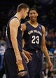 Oct 25, 2013; Orlando, FL, USA; New Orleans Pelicans power forward Anthony Davis (23) and power forward Jason Smith (14) talk against the Orlando Magic during the first quarter at Amway Center. Mandatory Credit: Kim Klement-USA TODAY Sports