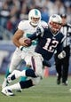 Oct 27, 2013; Foxborough, MA, USA; New England Patriots quarterback Tom Brady (12) runs against the Miami Dolphins during the fourth quarter of their 27-17 win at Gillette Stadium. Mandatory Credit: Winslow Townson-USA TODAY Sports