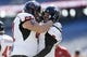 Nov 2, 2013; Foxborough, MA, USA; Northern Illinois Huskies quarterback Jordan Lynch (6) is congratulated by teammates after scoring against the Massachusetts Minutemen during the first quarter at Gillette Stadium. Mandatory Credit: David Butler II-USA TODAY Sports