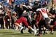 Nov 2, 2013; Foxborough, MA, USA; Massachusetts Minutemen quarterback Mike Wegzyn (11) runs the ball against the Northern Illinois Huskies during the second quarter at Gillette Stadium. Mandatory Credit: David Butler II-USA TODAY Sports