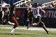 Nov 2, 2013; Foxborough, MA, USA; Northern Illinois Huskies wide receiver Juwan Brescacin (11) runs the ball for a touchdown against Massachusetts Minutemen defensive back Randall Jette (4) during the second quarter at Gillette Stadium. Mandatory Credit: David Butler II-USA TODAY Sports