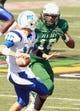 Nov 2, 2013; Birmingham, AL, USA; UAB Blazers defensive end Trey Grissett  (18) pressures Middle Tennessee State Blue Raiders quarterback Logan Kilgore (10) at Legion Field. Mandatory Credit: Marvin Gentry-USA TODAY Sports