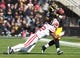 Nov 2, 2013; Iowa City, IA, USA; Wisconsin Badgers safety Desmen Southward (12) tackles Iowa Hawkeyes running back LeShun Daniels Jr. (29) in the first half at Kinnick Stadium. Mandatory Credit: Reese Strickland-USA TODAY Sports