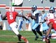 Nov 2, 2013; Raleigh, NC, USA; North Carolina Tar Heels quarterback Marquise Williams (12) looks to throw as North Carolina State Wolfpack linebacker Rodman Noel (5) defends during the first half at Carter Finley Stadium. Mandatory Credit: Rob Kinnan-USA TODAY Sports