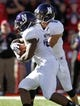 Nov 2, 2013; Lincoln, NE, USA; Northwestern Wildcats quarterback Kain Colter (2) hands off to running back Treyvon Green (22) during the game against the Nebraska Cornhuskers at Memorial Stadium. Mandatory Credit: Bruce Thorson-USA TODAY Sports