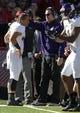 Nov 2, 2013; Lincoln, NE, USA; Northwestern Wildcats head coach Pat Fitzgerald congratulates quarterback Kain Colter (2) after a touchdown against the Nebraska Cornhuskers at Memorial Stadium. Mandatory Credit: Bruce Thorson-USA TODAY Sports