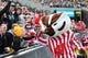 Nov 2, 2013; Iowa City, IA, USA; The Wisconsin Badgers mascot Bucky gives a high five to 5 year old Iowa Hawkeyes fan Jackson Bellcock of Carroll, Iowa at Kinnick Stadium.  Wisconsin beat Iowa 28-9. Mandatory Credit: Reese Strickland-USA TODAY Sports