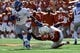 Nov 2, 2013; Austin, TX, USA; Texas Longhorns linebacker Steve Edmund (33) tackles Kansas Jayhawks halfback Darrian Miller (6) during the second quarter at Darrell K Royal-Texas Memorial Stadium. Mandatory Credit: Brendan Maloney-USA TODAY Sports
