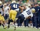 Nov 2, 2013; South Bend, IN, USA; Navy Midshipmen quarterback Keenan Reynolds (19) is tackled by Notre Dame Fighting Irish safety Matthias Farley (41) in the second quarter at Notre Dame Stadium. Notre Dame was penalized for unnecessary roughness on the play. Mandatory Credit: Matt Cashore-USA TODAY Sports