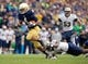 Nov 2, 2013; South Bend, IN, USA; Notre Dame Fighting Irish running back George Atkinson III (4) runs for a touchdown as Navy Midshipmen cornerback Brendon Clements (1) defends in the first quarter at Notre Dame Stadium. Mandatory Credit: Matt Cashore-USA TODAY Sports