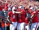 Nov 2, 2013; Raleigh, NC, USA; North Carolina State Wolfpack quarterback Brandon Mitchell (8) is congratulated by teammates Alex Barr (71) and David Grinnage (86) after a first quarter touchdown against the North Carolina Tar Heels at Carter Finley Stadium. Mandatory Credit: Rob Kinnan-USA TODAY Sports