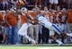 Nov 2, 2013; Austin, TX, USA; Texas Longhorns wide receiver Marcus Johnson (7) makes a catch ahead of Kansas Jayhawks safety Cassius Sendish (33) during the third quarter at Darrell K Royal-Texas Memorial Stadium. Texas beat Kansas 35-13. Mandatory Credit: Brendan Maloney-USA TODAY Sports