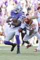 Nov 2, 2013; Manhattan, KS, USA; Kansas State Wildcats quarterback Daniel Sams (4) is tackled by Iowa State Cyclones linebacker Jeremiah George (52) during the second half at Bill Snyder Family Stadium. The Wildcats defeat the Cyclones 41-7. Mandatory Credit: Jasen Vinlove-USA TODAY Sports