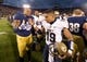 Nov 2, 2013; South Bend, IN, USA; Notre Dame Fighting Irish linebacker Kendall Moore (8) shakes hands with Navy Midshipmen quarterback Keenan Reynolds (19) after Notre Dame defeated Navy 38-34 at Notre Dame Stadium. Mandatory Credit: Matt Cashore-USA TODAY Sports