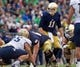 Nov 2, 2013; South Bend, IN, USA; Notre Dame Fighting Irish quarterback Tommy Rees (11) yells to his offensive line in the first quarter against the Navy Midshipmen at Notre Dame Stadium. Notre Dame won 38-34. Mandatory Credit: Matt Cashore-USA TODAY Sports