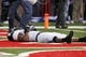 Nov 2, 2013; Lincoln, NE, USA; Northwestern Wildcats linebacker Chi Chi Ariguzo (44) lies in the end zone after the Nebraska Cornhuskers scored the game-winning touchdown on the last play of the game at Memorial Stadium. Nebraska won 27-24. Mandatory Credit: Bruce Thorson-USA TODAY Sports