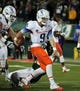 Nov 2, 2013; Fort Collins, CO, USA; Boise State Broncos quarterback Grant Hedrick (9) scores a touchdown against Colorado State Rams safety Trent Matthews (16) during the first quarter at Hughes Stadium. Mandatory Credit: Troy Babbitt-USA TODAY Sports