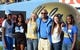 Nov 2, 2013; Pasadena, CA, USA; UCLA Bruins womens track coach John Henry Johnson (center) attends the game against the Colorado Buffaloes at Rose Bowl. From left: Deja Parrish and Gabriella Cantrell and Tiana Bonds and Johnson and Madisen Richards and Daria Cook. Mandatory Credit: Kirby Lee-USA TODAY Sports
