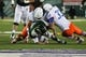 Nov 2, 2013; Fort Collins, CO, USA; Colorado State Rams quarterback Garrett Grayson (18) fumbles the ball against Boise State Broncos defensive tackle Justin Taimatuia (90) and linebacker Gabe Perez (33) during the second quarter at Hughes Stadium. Mandatory Credit: Troy Babbitt-USA TODAY Sports