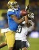 Nov 2, 2013; Pasadena, CA, USA; UCLA Bruins receiver Shaquelle Evans (1) is defended by Colorado Buffaloes cornerback Greg Henderson (20) at Rose Bowl. UCLA defeated Colorado 45-23. Mandatory Credit: Kirby Lee-USA TODAY Sports