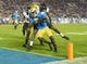Nov 2, 2013; Pasadena, CA, USA; UCLA Bruins receiver Devin Fuller (7) is defended by Colorado Buffaloes cornerback Jeffrey Hall (16) on an 8-yard touchdown run in the fourth quarter at Rose Bowl. UCLA defeated Colorado 45-23. Mandatory Credit: Kirby Lee-USA TODAY Sports