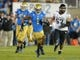 Nov 2, 2013; Pasadena, CA, USA; UCLA Bruins receiver Shaquelle Evans (1) carries the ball on a 36-yard reception in the fourth quarter against the Colorado Buffaloes at Rose Bowl. UCLA defeated Colorado 45-23. Mandatory Credit: Kirby Lee-USA TODAY Sports