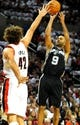 Nov 2, 2013; Portland, OR, USA; San Antonio Spurs point guard Tony Parker (9) shoots the ball over Portland Trail Blazers center Robin Lopez (42) during the first quarter of the game at  the Moda Center. Mandatory Credit: Steve Dykes-USA TODAY Sports