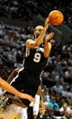 Nov 2, 2013; Portland, OR, USA; San Antonio Spurs point guard Tony Parker (9) passes the ball during the first quarter of the game against the Portland Trail Blazers at  the Moda Center. Mandatory Credit: Steve Dykes-USA TODAY Sports