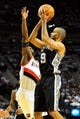 Nov 2, 2013; Portland, OR, USA; San Antonio Spurs point guard Tony Parker (9) shoots the ball over Portland Trail Blazers shooting guard Wesley Matthews (2) during the first quarter of the game at  the Moda Center. Mandatory Credit: Steve Dykes-USA TODAY Sports